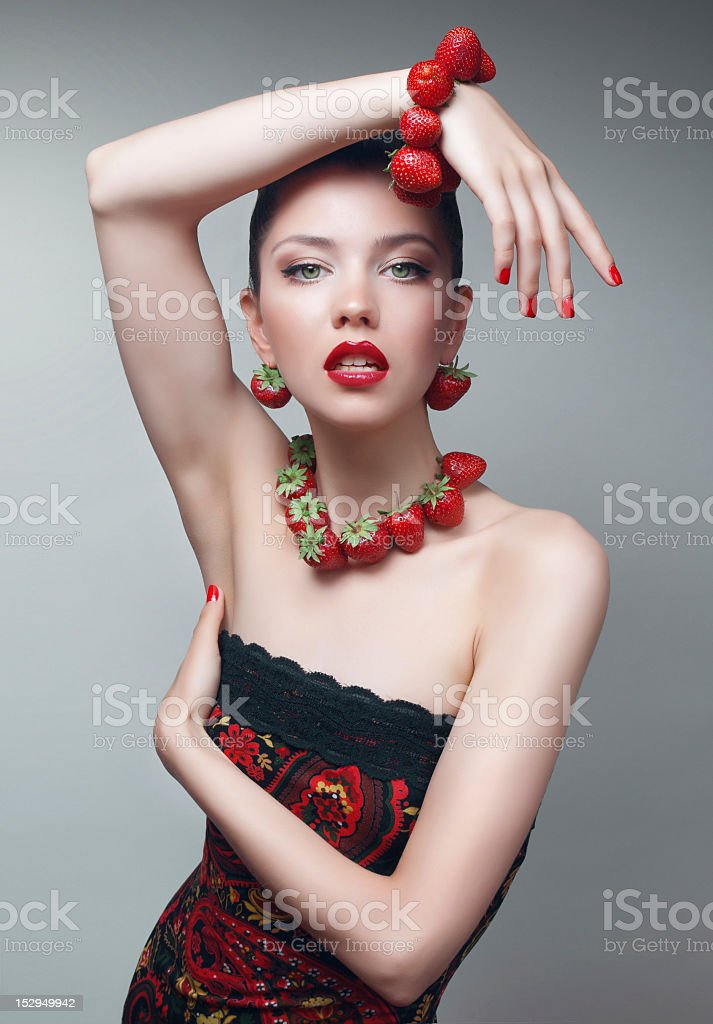 Sexy girl with strawberry braclet and necklace. royalty-free stock photo