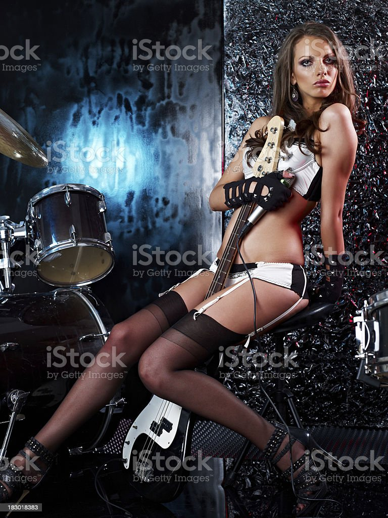 Sexy girl with the guitar royalty-free stock photo