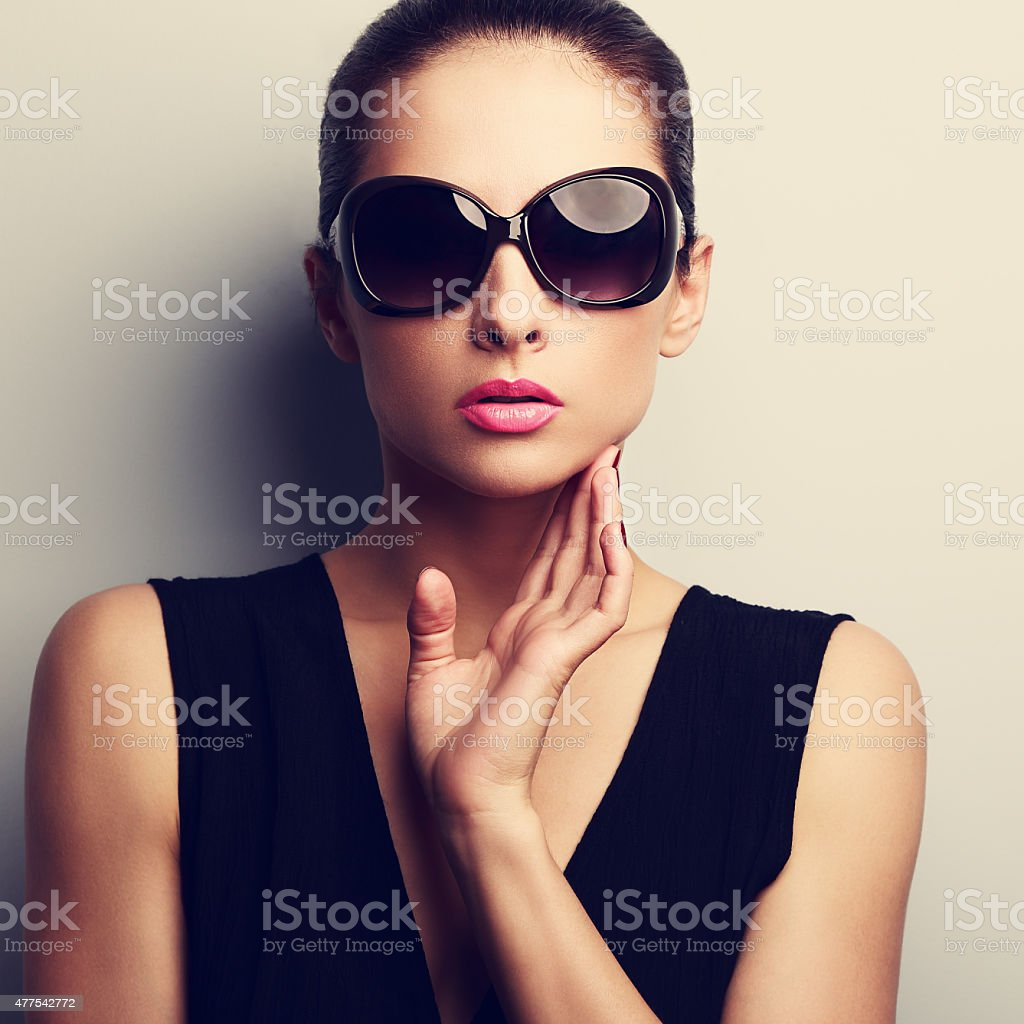 Sexy glamour female model in trendy sun glasses with hand stock photo