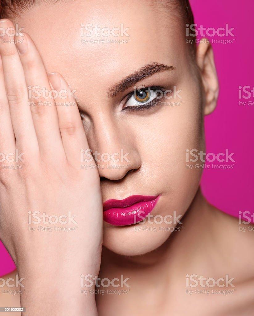 Sexy glosy pink lipstick. Smokey eye make up. Fashion model stock photo