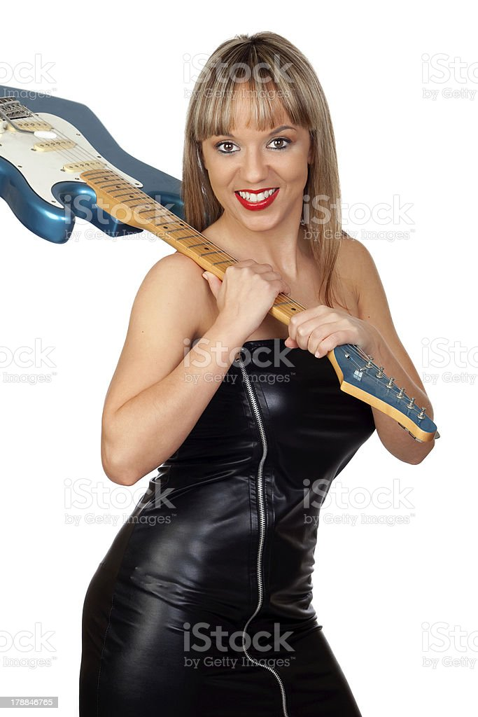 Sexy guitarist with a black leather dress royalty-free stock photo