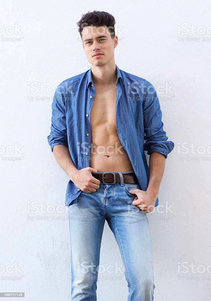 Sexy guy posing with open shirt stock photo