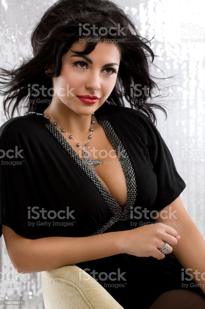 Beautiful, Sexy Hispanic Young Woman Model Posing in Chair stock photo