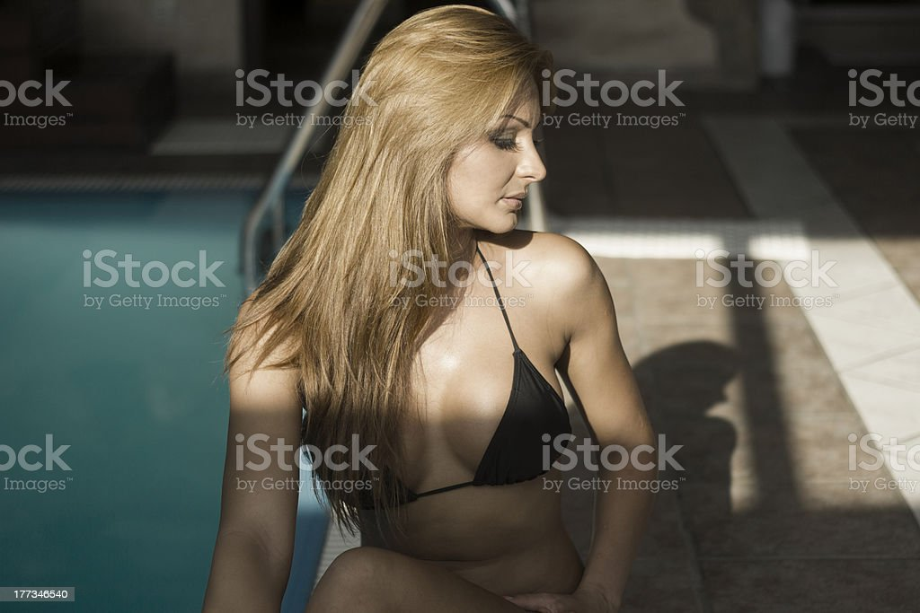 Sexy indian woman by side of the pool royalty-free stock photo