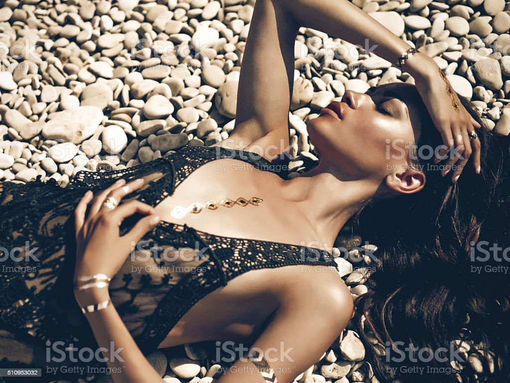 Sexy lady at beach stock photo