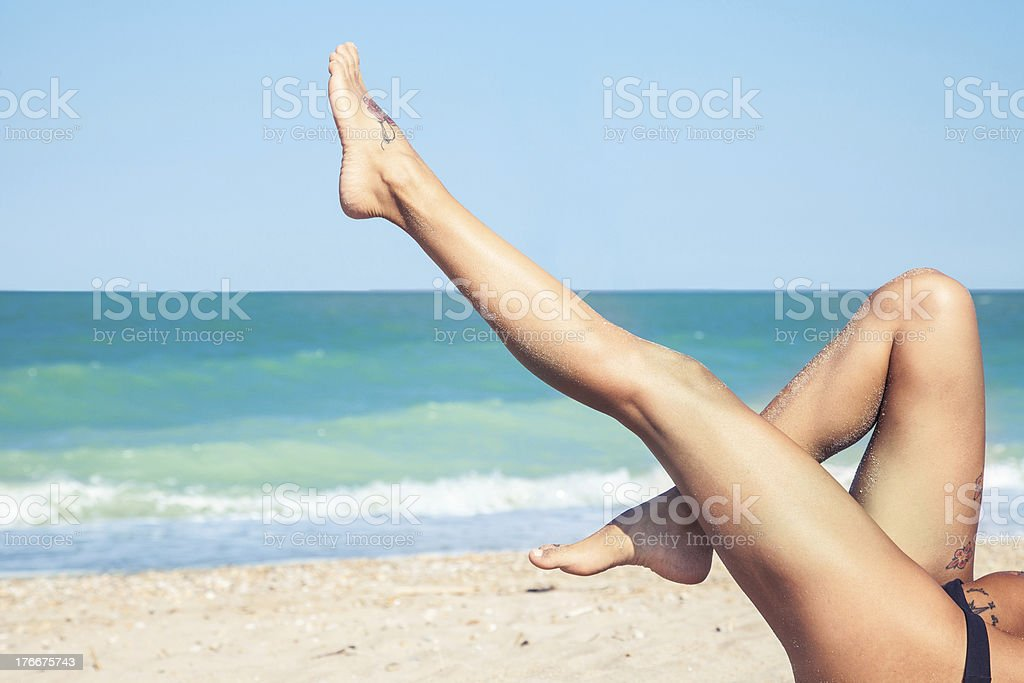 Sexy legs on the beach and copyspace royalty-free stock photo