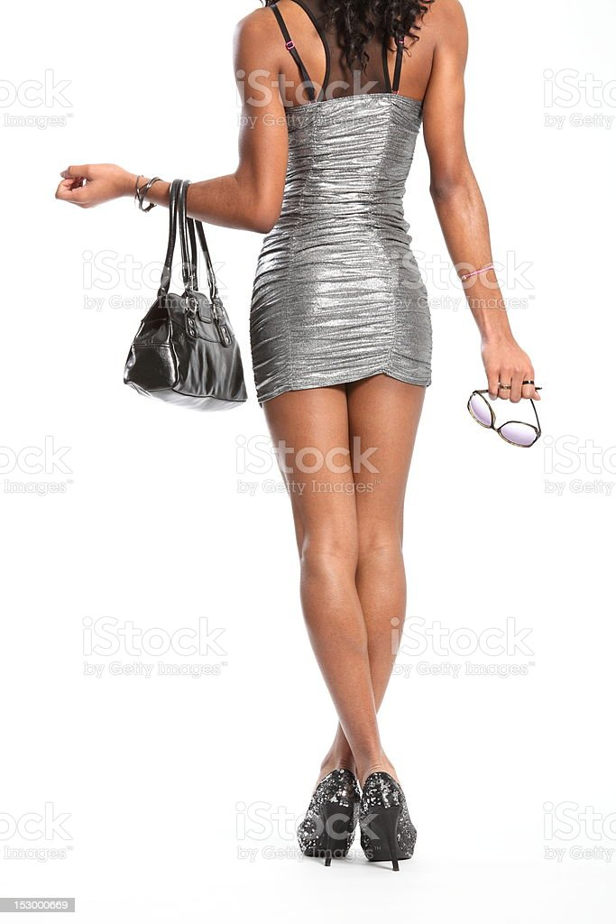 Sexy long legs of fashion model in short dress stock photo