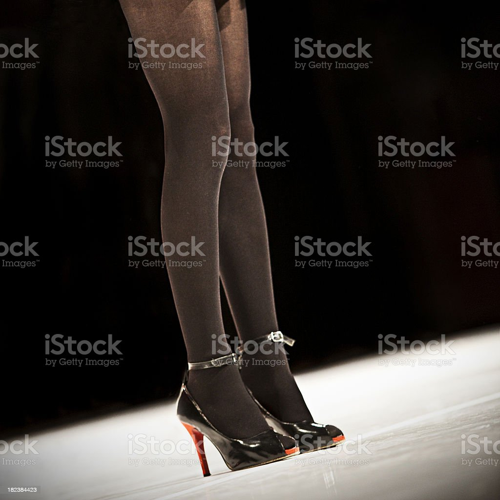 Sexy long legs on fashion show royalty-free stock photo
