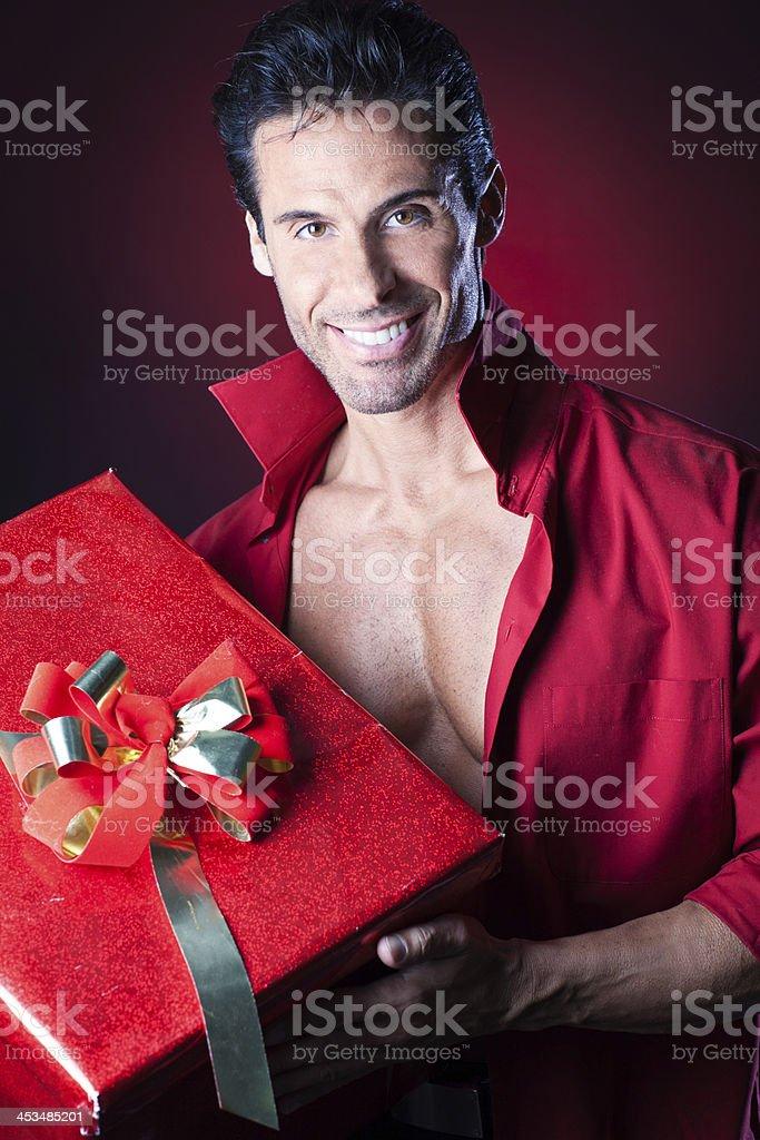 Sexy macho man with big gift stock photo