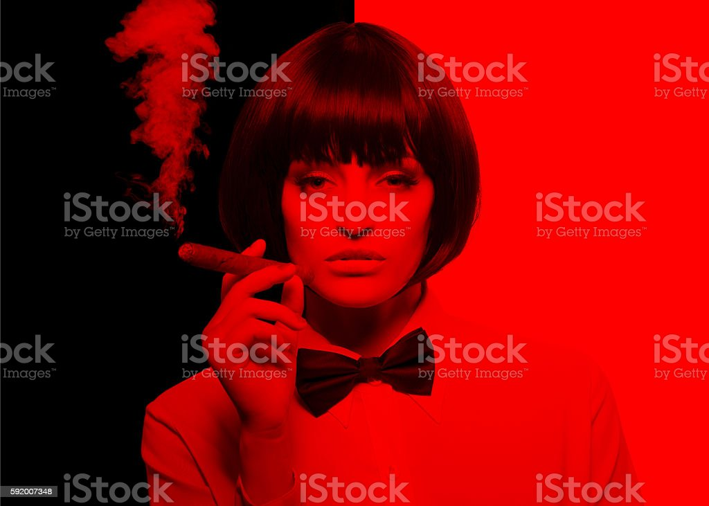 Sexy mafiosi woman in tux substracted coloring to red stock photo