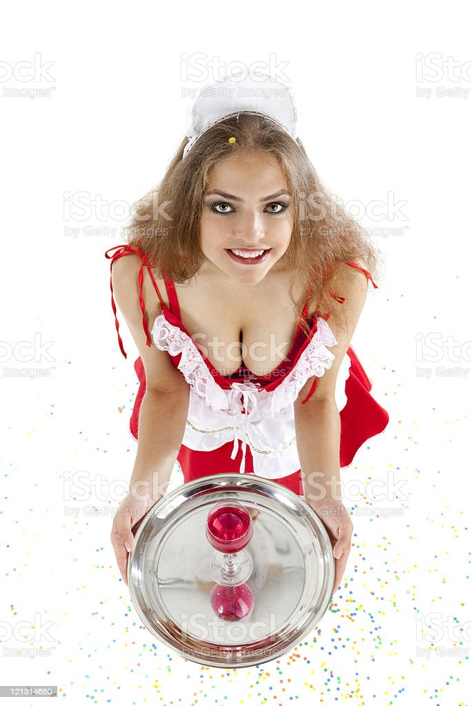 Sexy maid holding tray with glass of red wine. stock photo