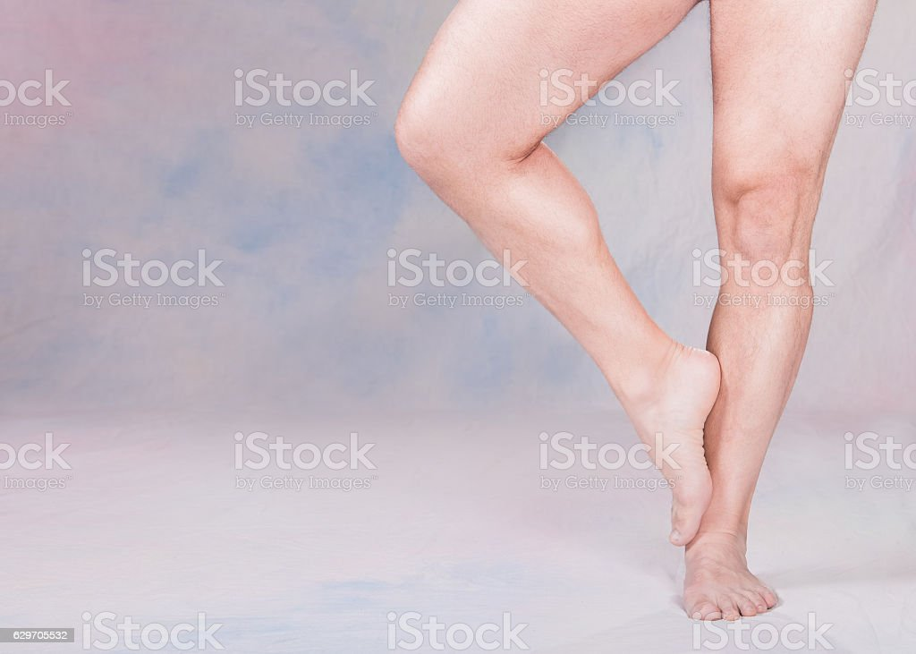 Athletic man\'s bare legs to one side of the image leaving room for...