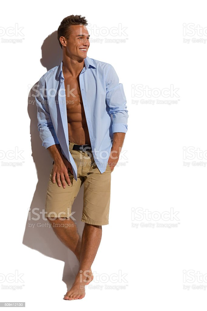 Sexy Male Model Against White Wall stock photo