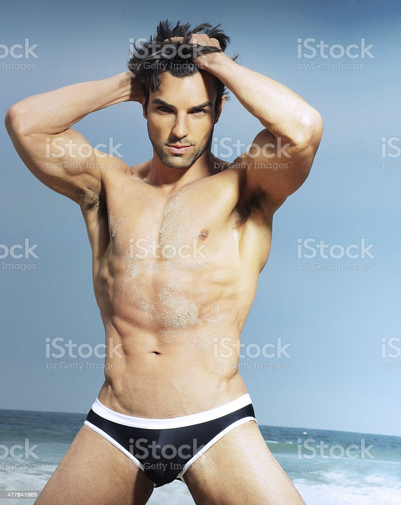 Sexy male model in fashion swimwear posing royalty-free stock photo