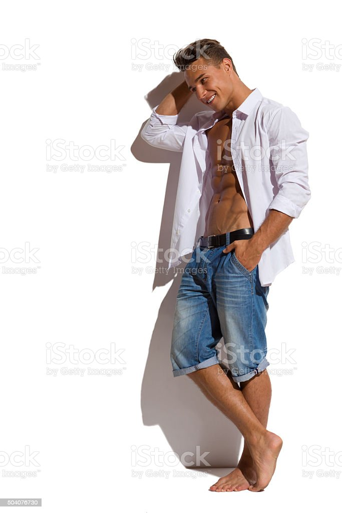 Sexy Male Model In Unbuttoned Shirt stock photo