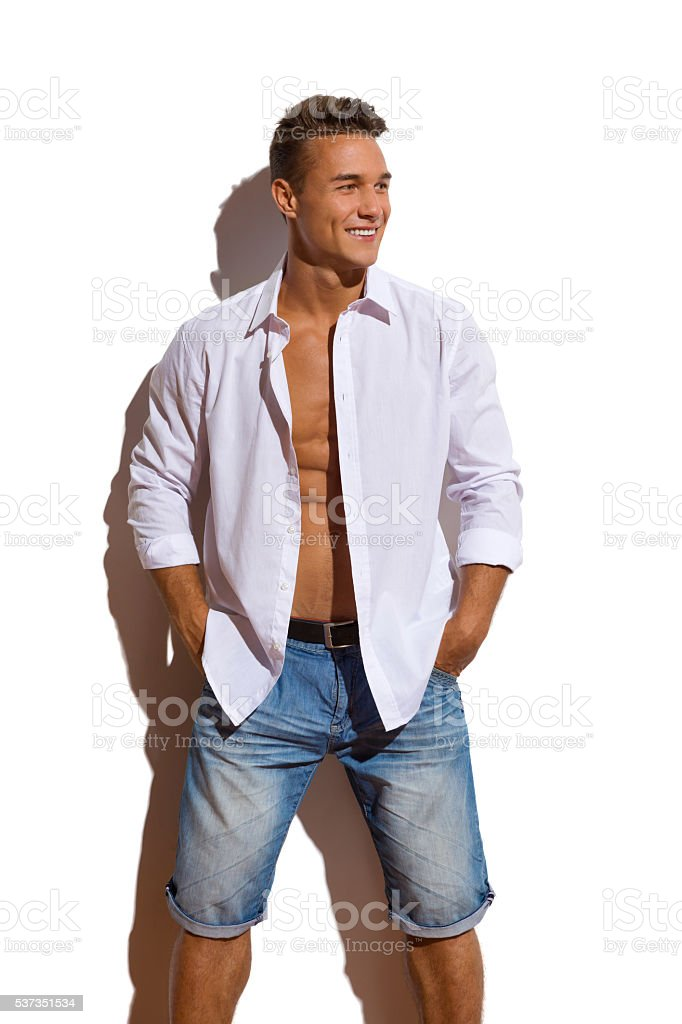Sexy Male Model In Unbuttoned White Shirt stock photo