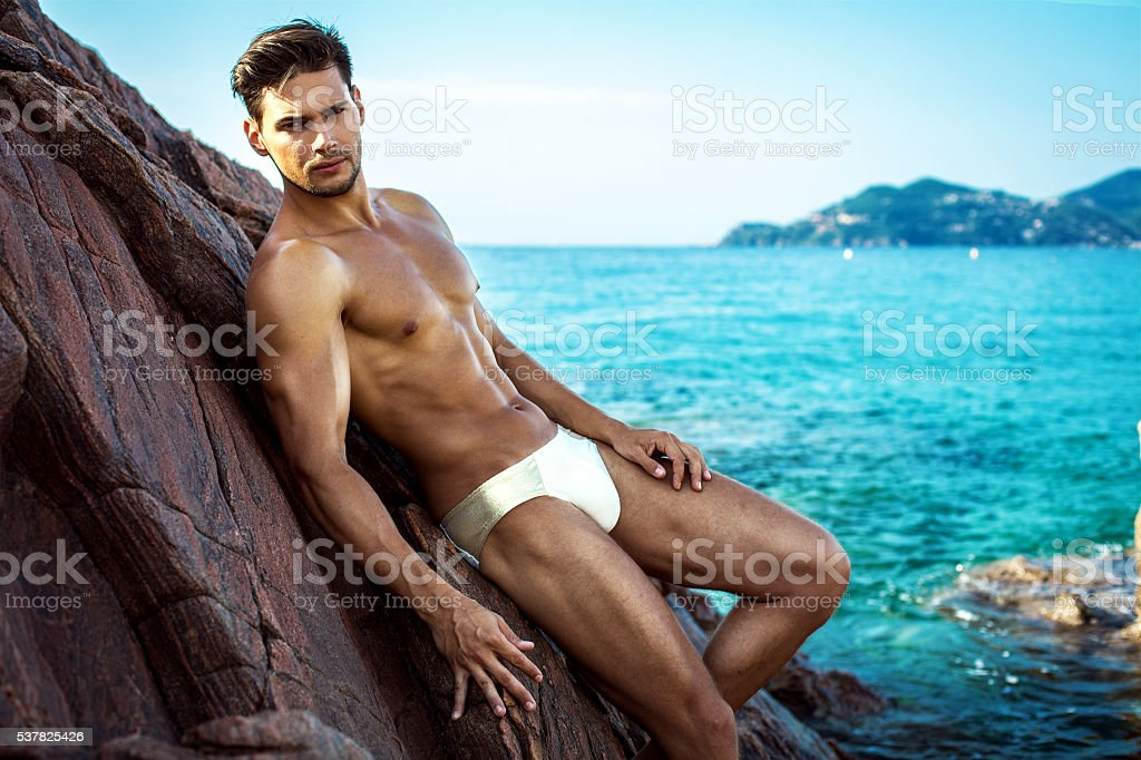 Sexy Male Model On The Beach In Men's Underwear stock photo