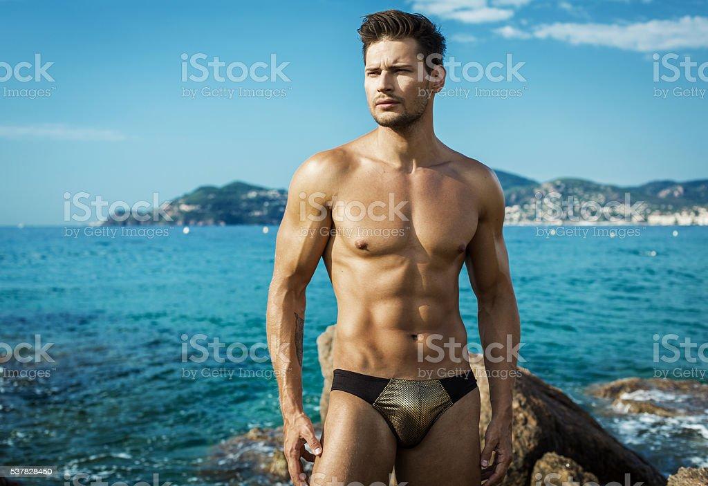 Sexy Male Model On The Beach Wear Men's Underwear stock photo
