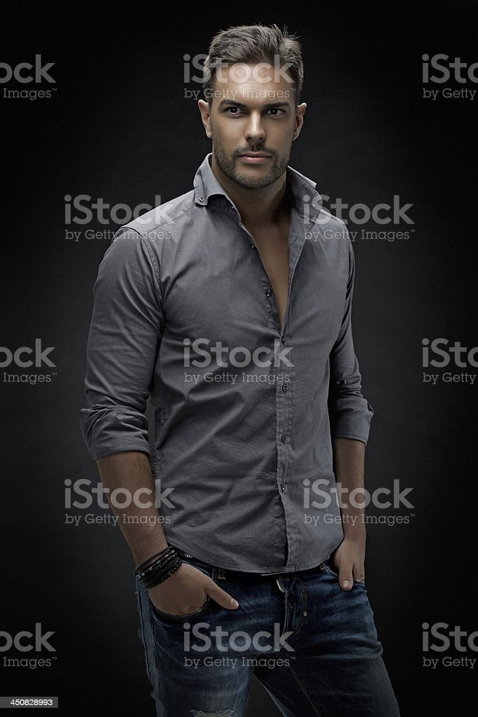 sexy male model posing in the studio stock photo