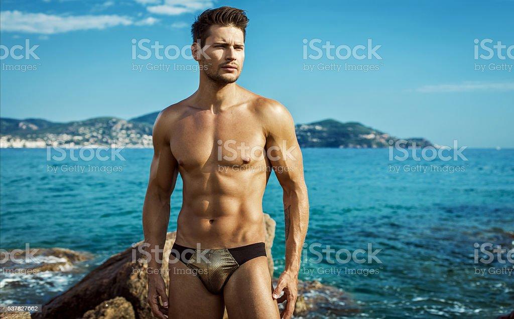 Sexy Male Model Wear Men's Underwear In Sea Scenery stock photo