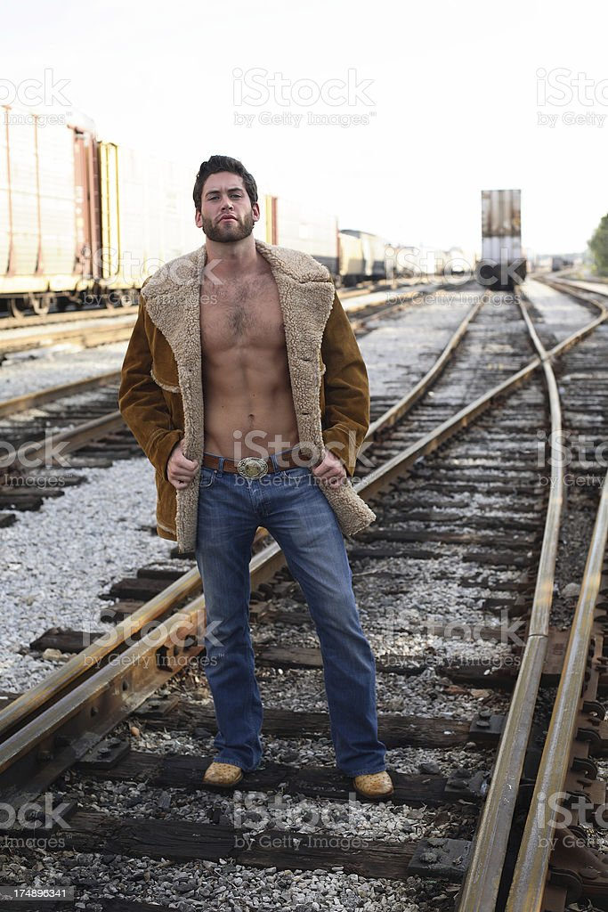 Sexy Male On Railroad Track royalty-free stock photo
