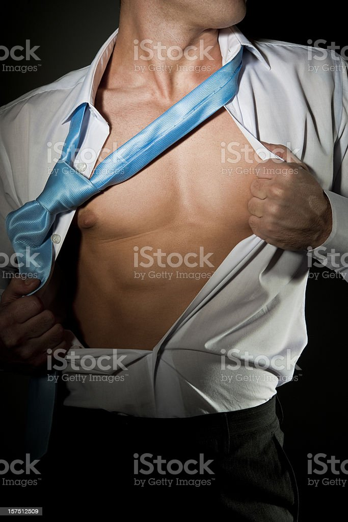 Sexy Male stripping off shirt and tie stock photo