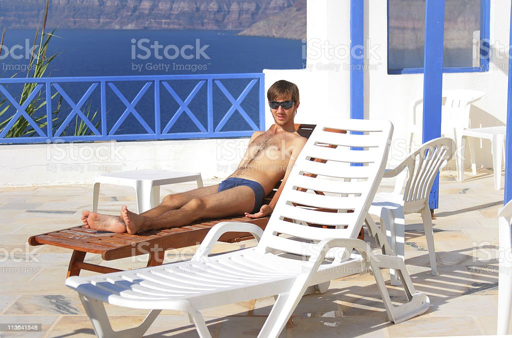 Sexy man at sunbed stock photo