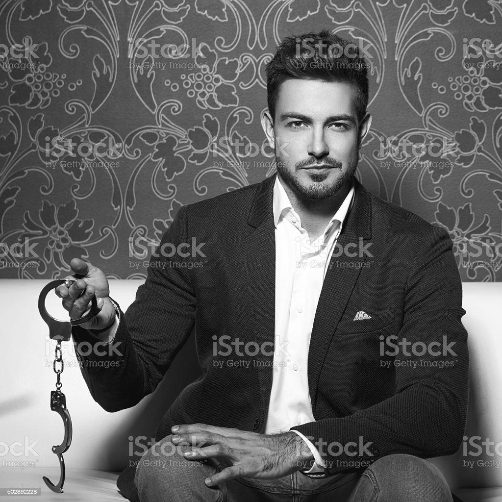 Sexy man holding handcuffs bdsm stock photo