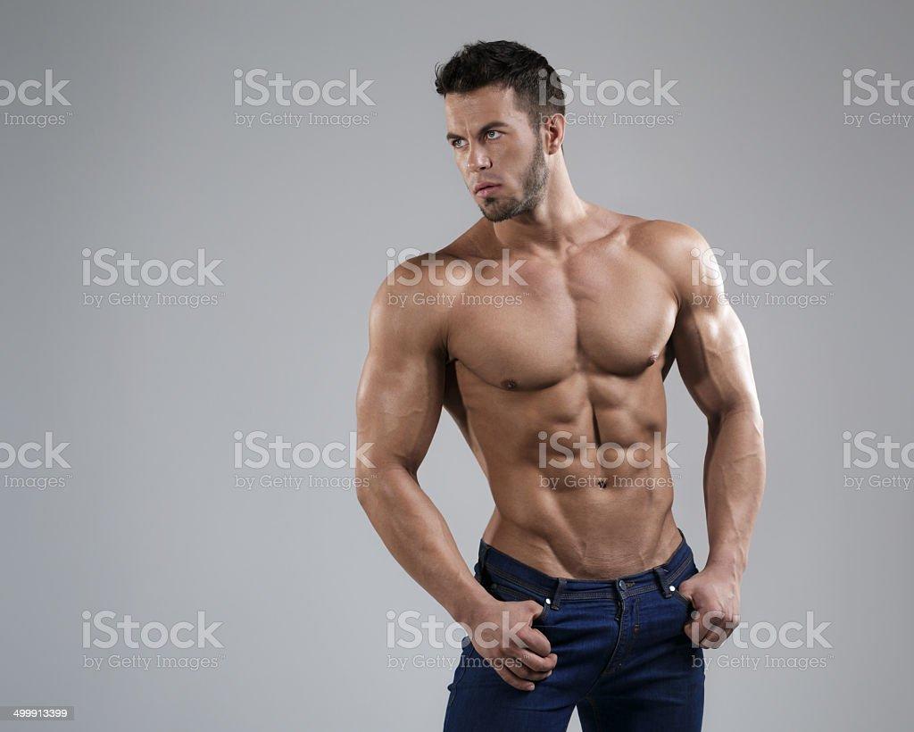 Sexy man in studio stock photo