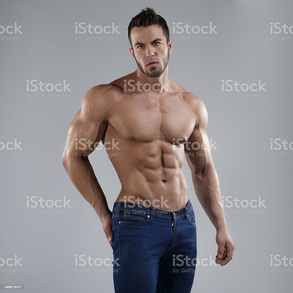 Sexy man in studio stock photo
