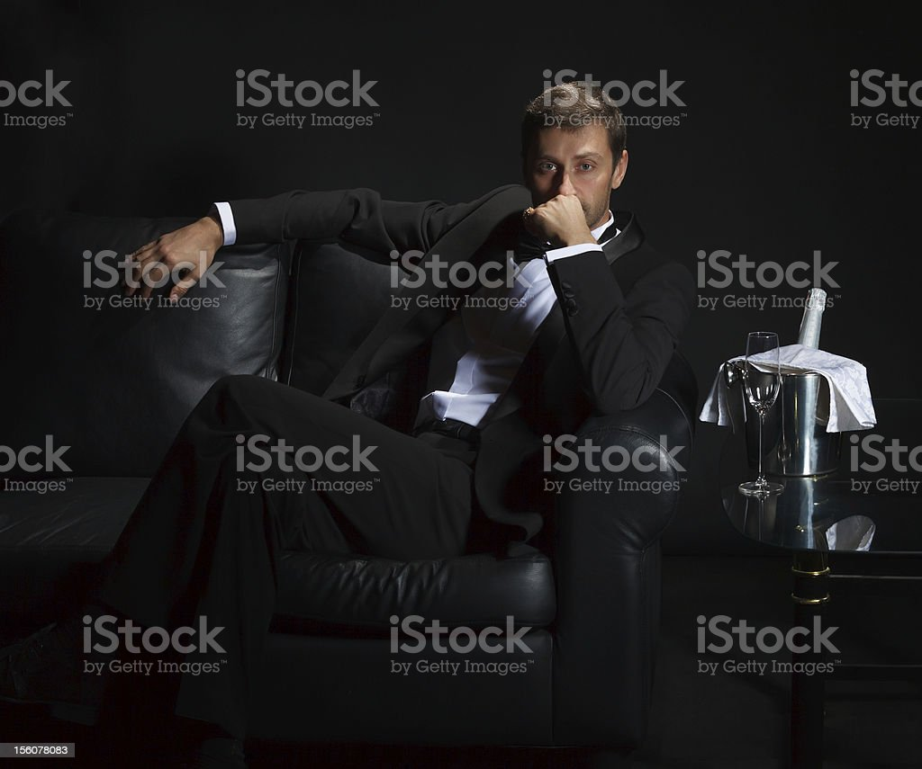 Sexy man in tuxedo waiting for his date stock photo
