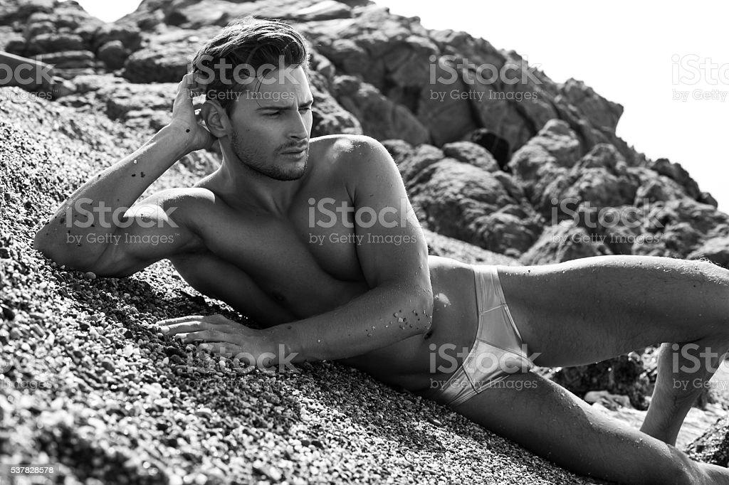 Sexy Man In Underwear Posing On The Beach stock photo