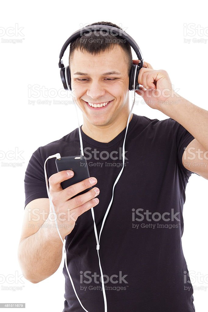sexy man listening mp3 player with headphones royalty-free stock photo