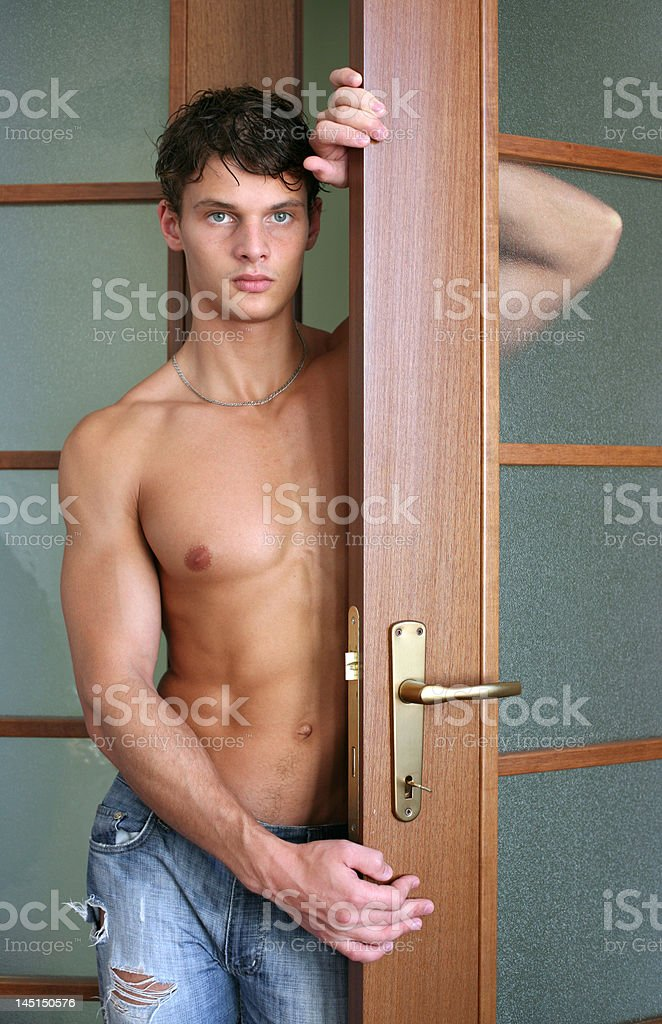 Sexy Man Looking Out the Door royalty-free stock photo