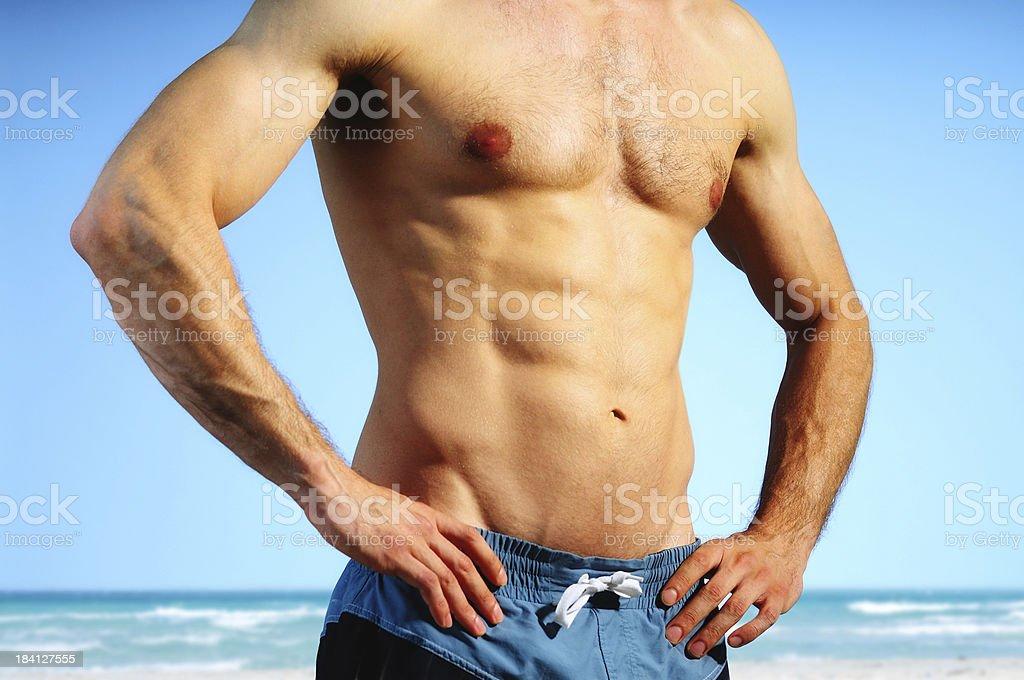Sexy man on the beach royalty-free stock photo