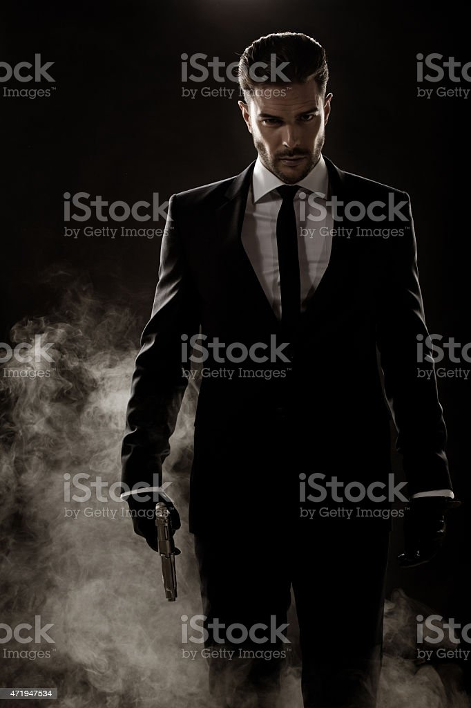 sexy man walking holding gun stock photo