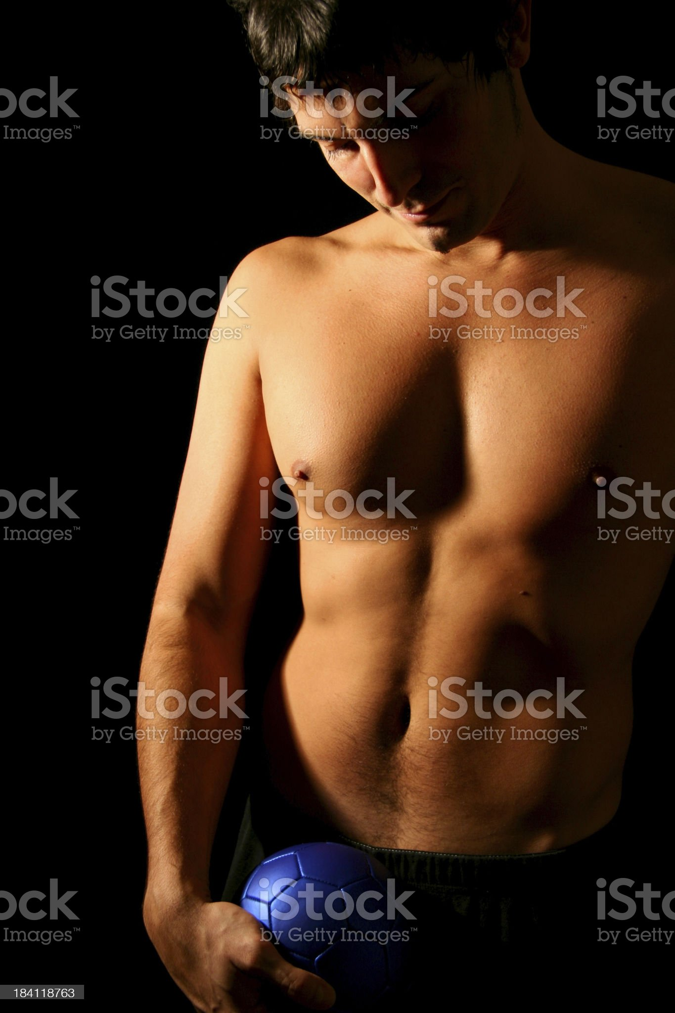 Sexy Man with a Blue Soccer Ball royalty-free stock photo