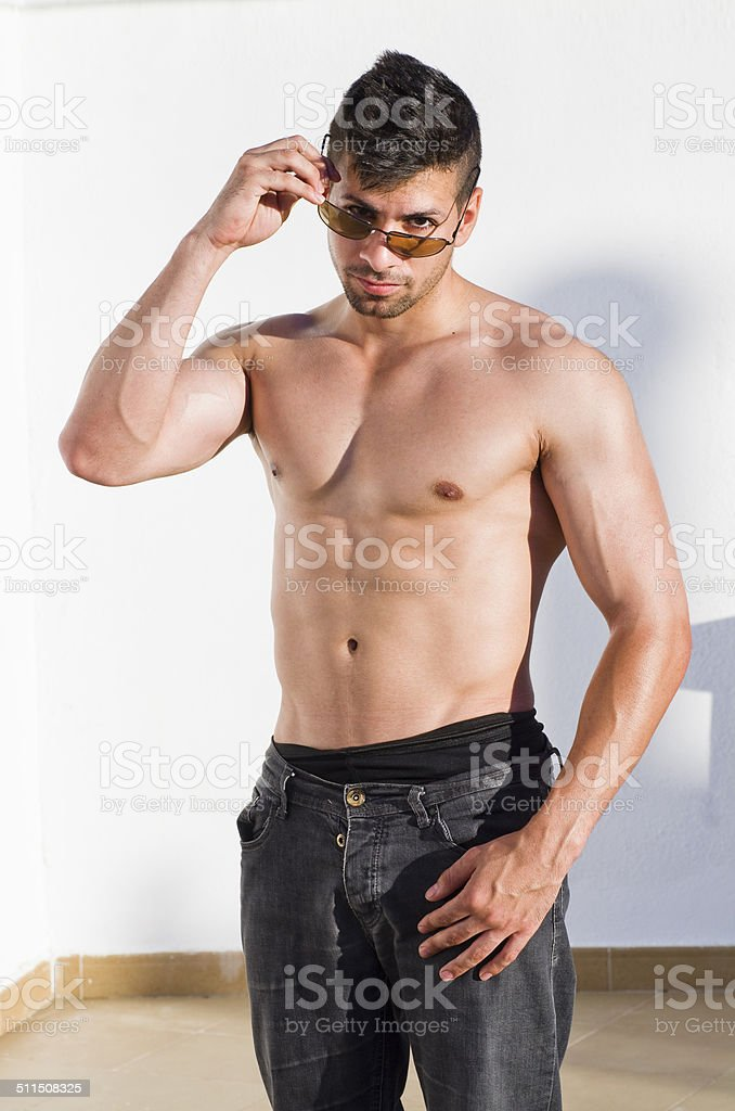 Sexy man with fitness torso looking at camera. stock photo