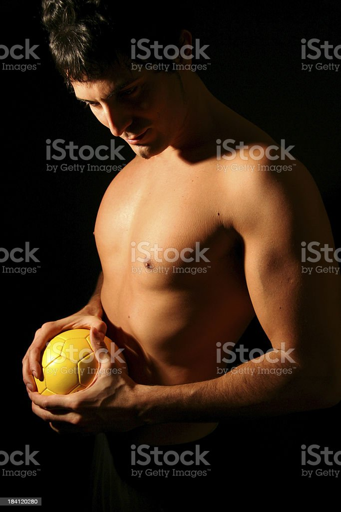 Sexy Man with Yellow Ball royalty-free stock photo