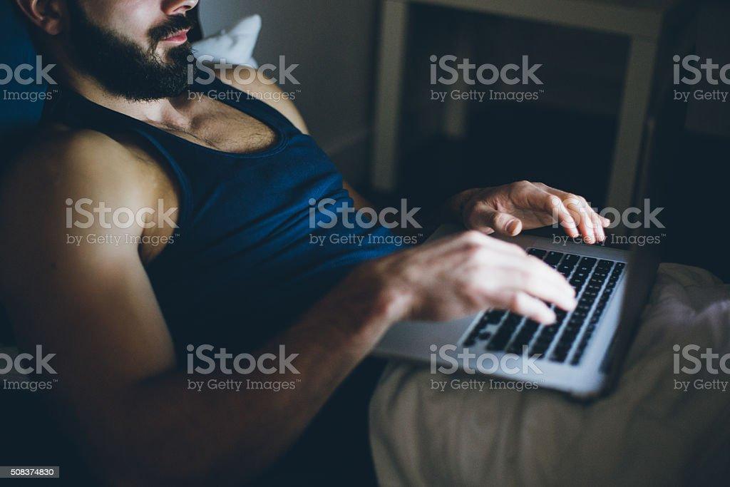 Sexy Man Working on Laptop stock photo