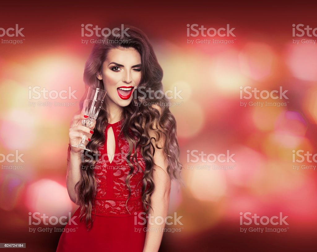 Sexy modell with glass of champagne at party, New year stock photo