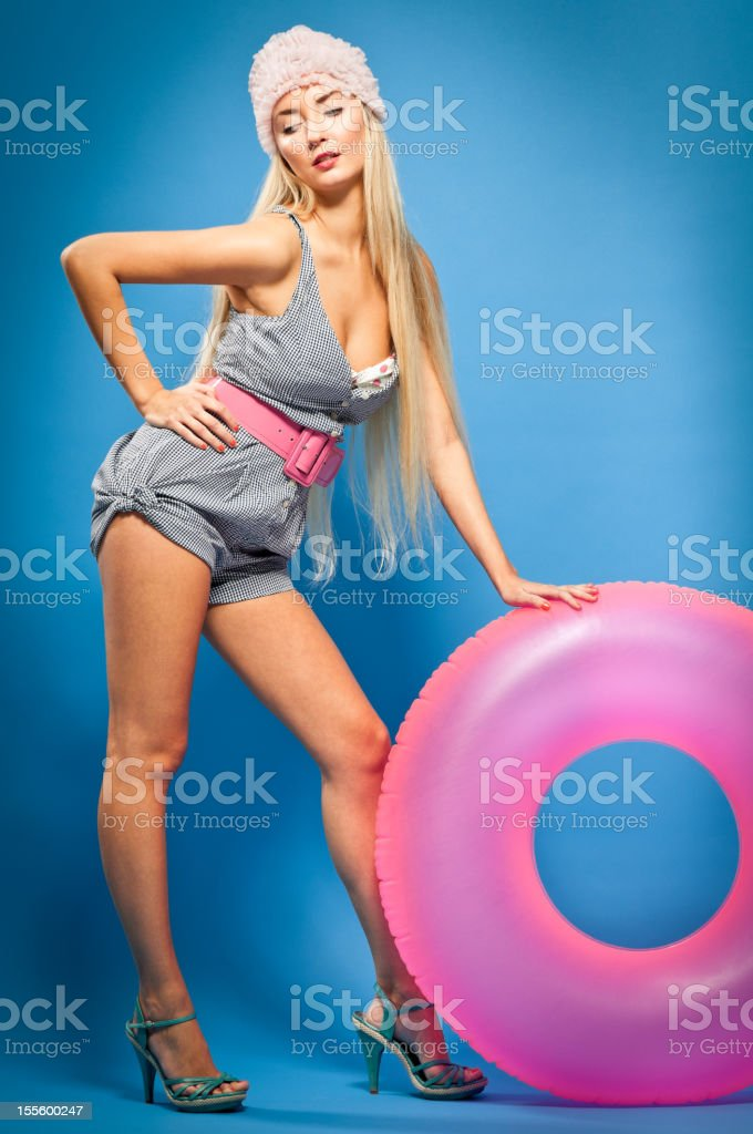 Sexy modern pin-up girl with inflatable pool raft royalty-free stock photo