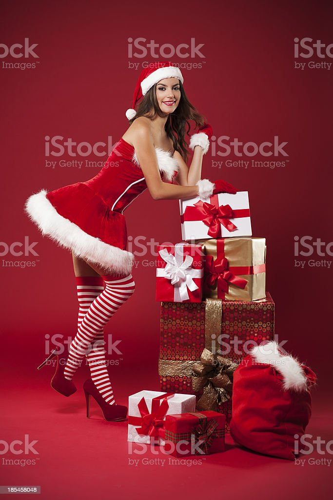Sexy Mrs claus with christmas gifts stock photo