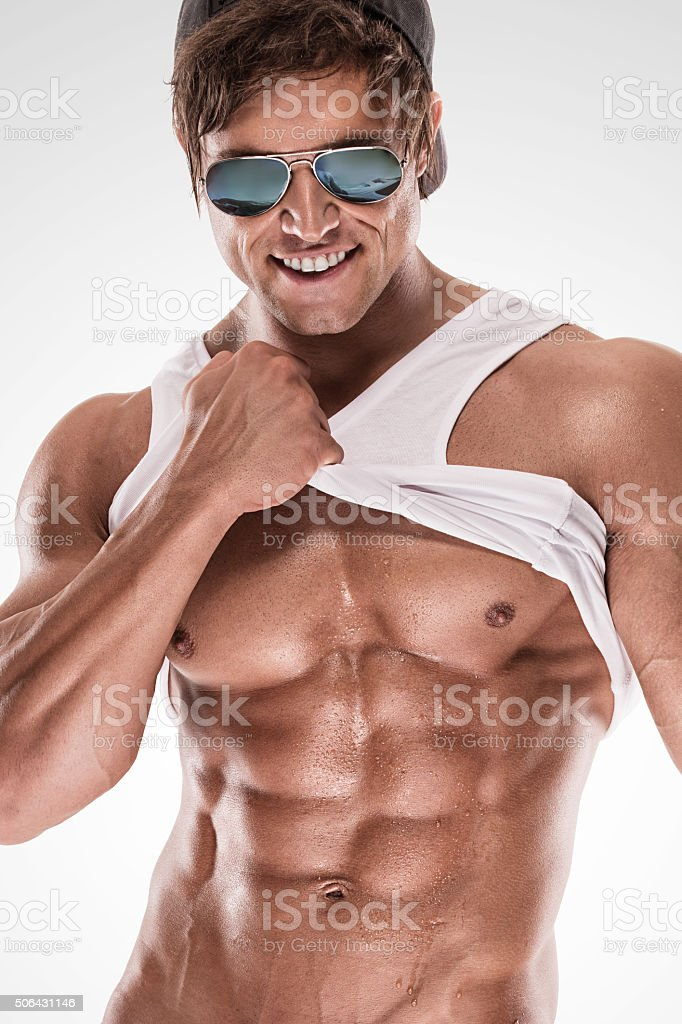 Sexy muscular fitness man showing sixpack muscles without fat stock photo