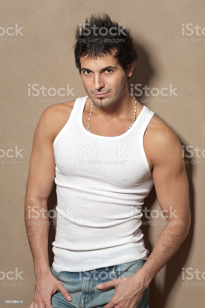 Sexy Muscular Male Model Posing in White Shirt royalty-free stock photo