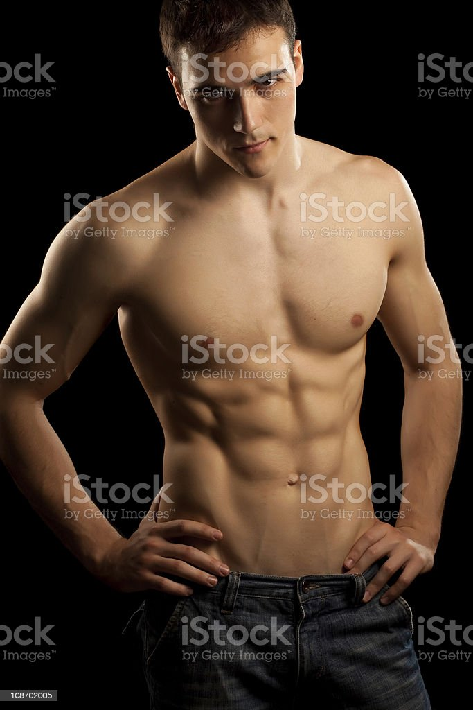 Sexy muscular man isolated on black stock photo