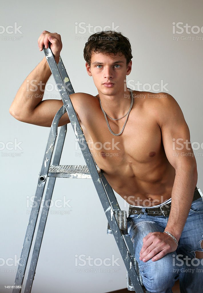 Sexy Muscular Man with a Stepladder royalty-free stock photo