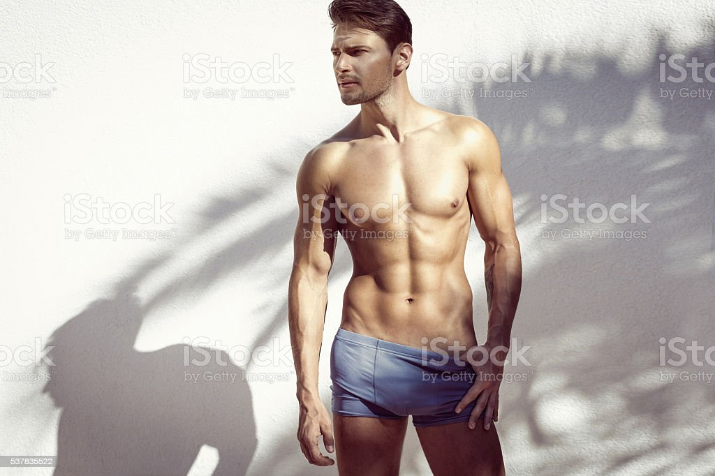 Sexy muscular model posing stock photo