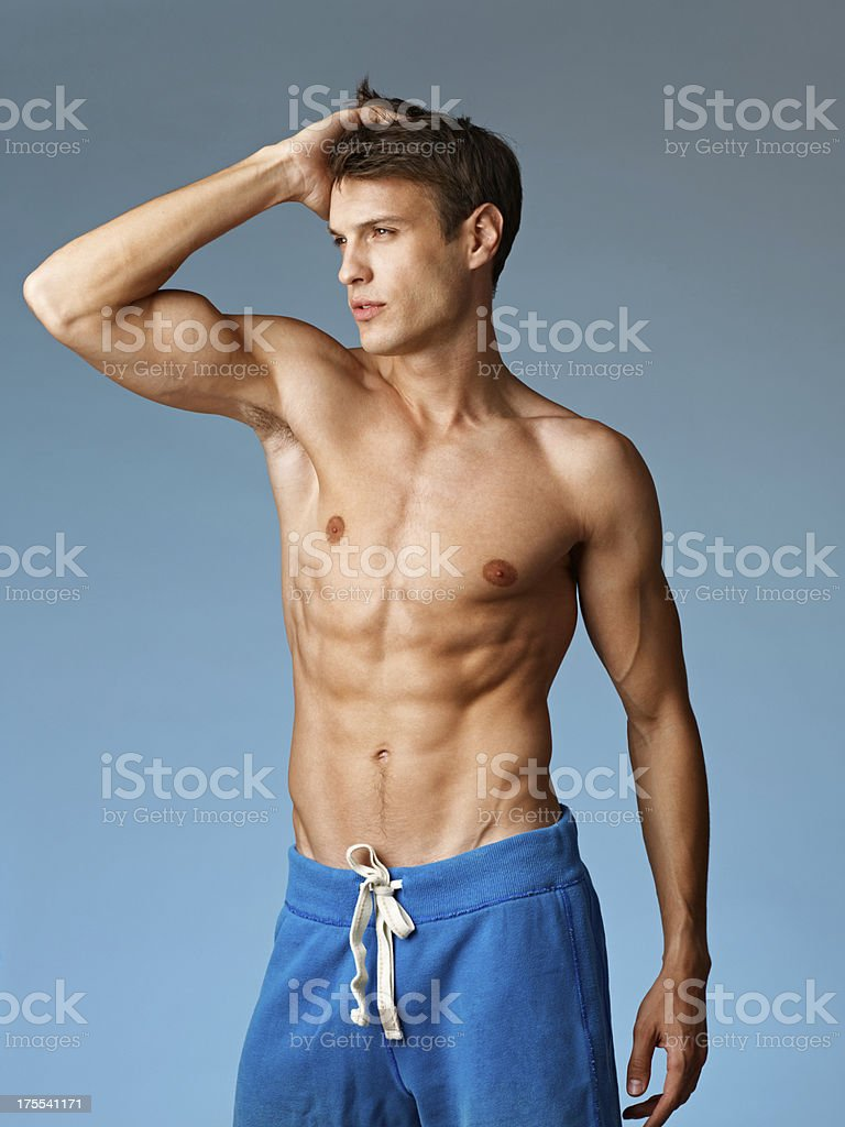 sexy muscular young man stripped to the waist royalty-free stock photo