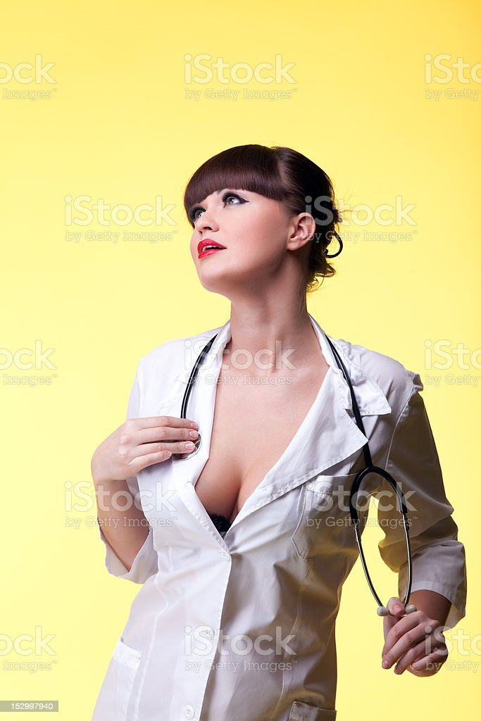 Sexy nurse pinup style with stethoscope royalty-free stock photo